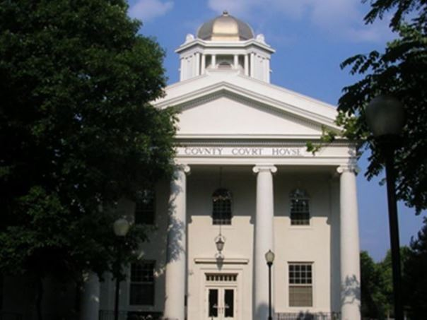 Kenton County Courthouse with with ionic columns and a shiny tin dome